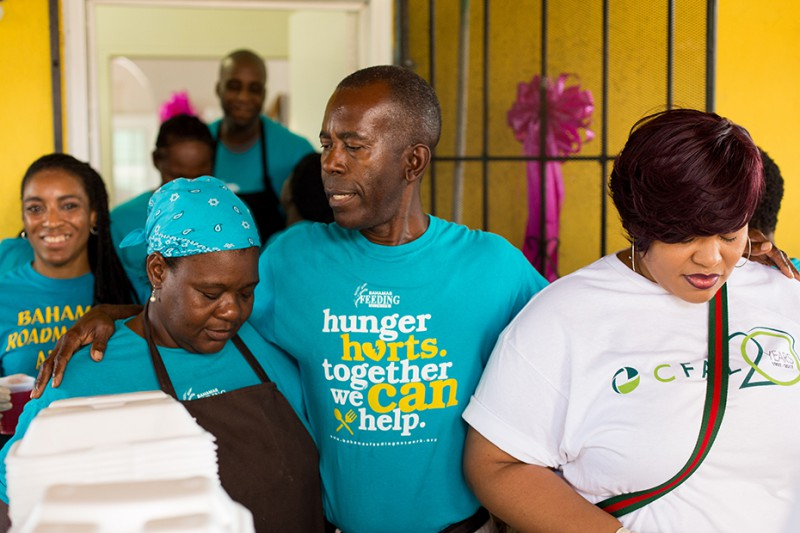 Philip Smith, the Executive Director of Bahamas Feeding Network, with volunteers from the organization and CFAL.