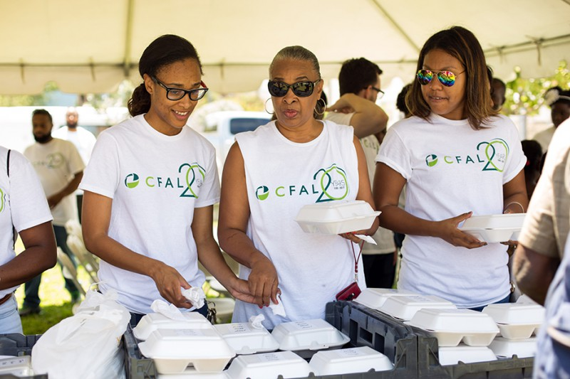 CFAL employees along with the Bahamas Feeding Network gathered to distribute food in Retirement Park.